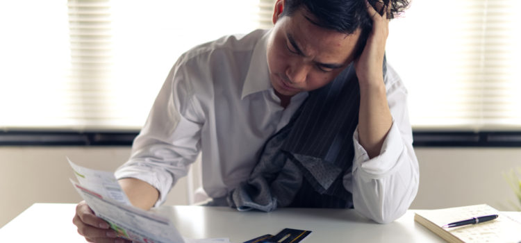 man stressed with debt